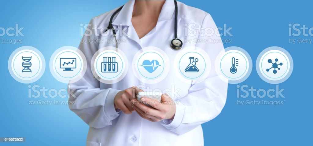 The doctor works with patients on the application. stock photo