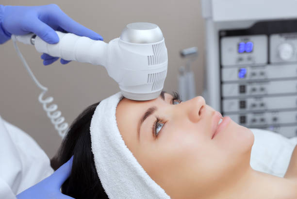 The doctor-cosmetologist makes the Cryotherapy procedure of the facial skin The doctor-cosmetologist makes the Cryotherapy procedure of the facial skin of a beautiful, young woman in a beauty salon.Cosmetology and professional skin care. cryotherapy stock pictures, royalty-free photos & images