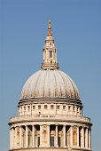 The dome of St Pauls Cathederal in London set against a deep blue sky