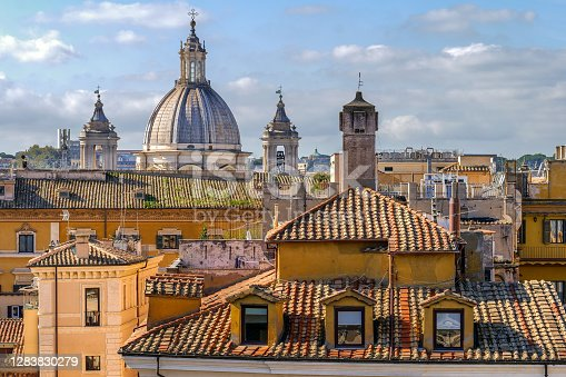 The rooftops of the iconic roman Pantheon quarter and a view of the dome of Sant'Agnese in Agone church, the Borromini's architect baroque masterpiece site in Piazza Navona, in the heart of Rome. Image in High Definition Format.