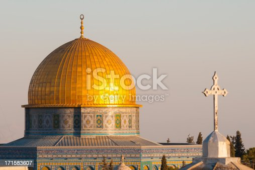 The Dome of the Rock (Islam) and the cross of a church (Christianity) in the old city of Jerusalem.