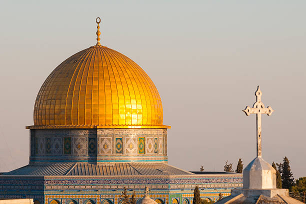 Islamic crescent and Christian cross in Jerusalem's Old City The Dome of the Rock (Islam) and the cross of a church (Christianity) in the old city of Jerusalem. historical palestine stock pictures, royalty-free photos & images