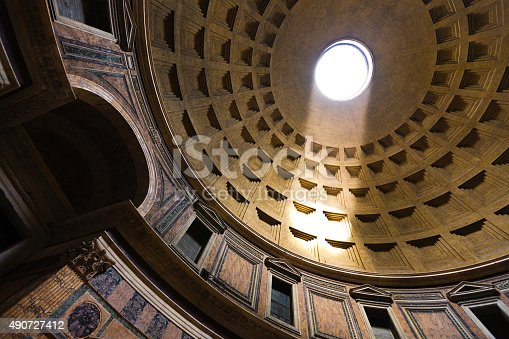 The interior dome of the Pantheon in Rome, Italy. The Pantheon, a historic monument built by the emperor Hadrian around 126 SD. The building, a circular rotunda under a concrete dome with a oculus opening to the sky on the top. It is the world largest unreinforced concrete dome, one of the best preserved ancient Roman architecture.