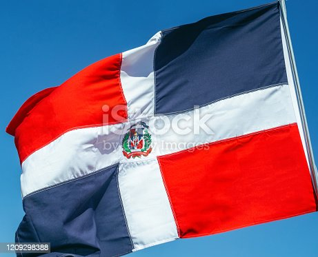 istock The Dominican  flag waving 1209298388
