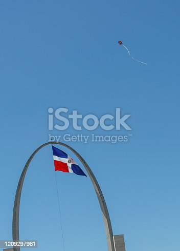 istock The Dominican flag with a kite 1209297981
