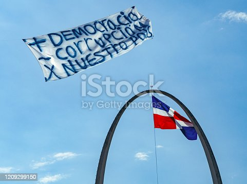 istock The Dominican flag with a sigh 1209299150