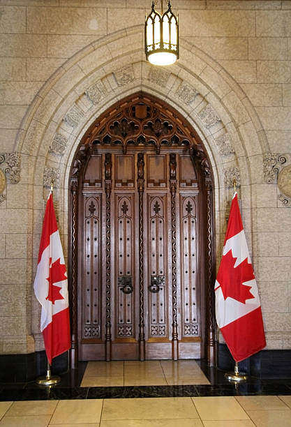 the door of house of commons - canada parliament stock photos and pictures