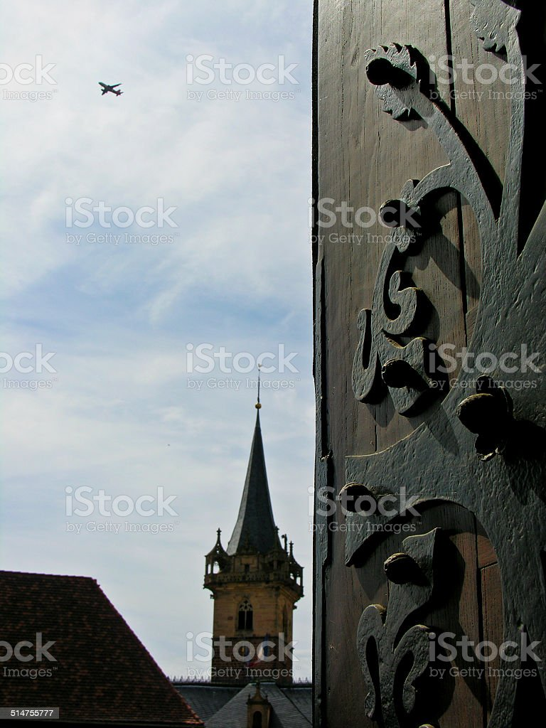 The door of the Obernai's cathedral, plane and a tower stock photo