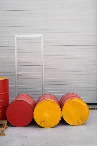 The door... Red and yellow painted barrels front of door... deleterious stock pictures, royalty-free photos & images
