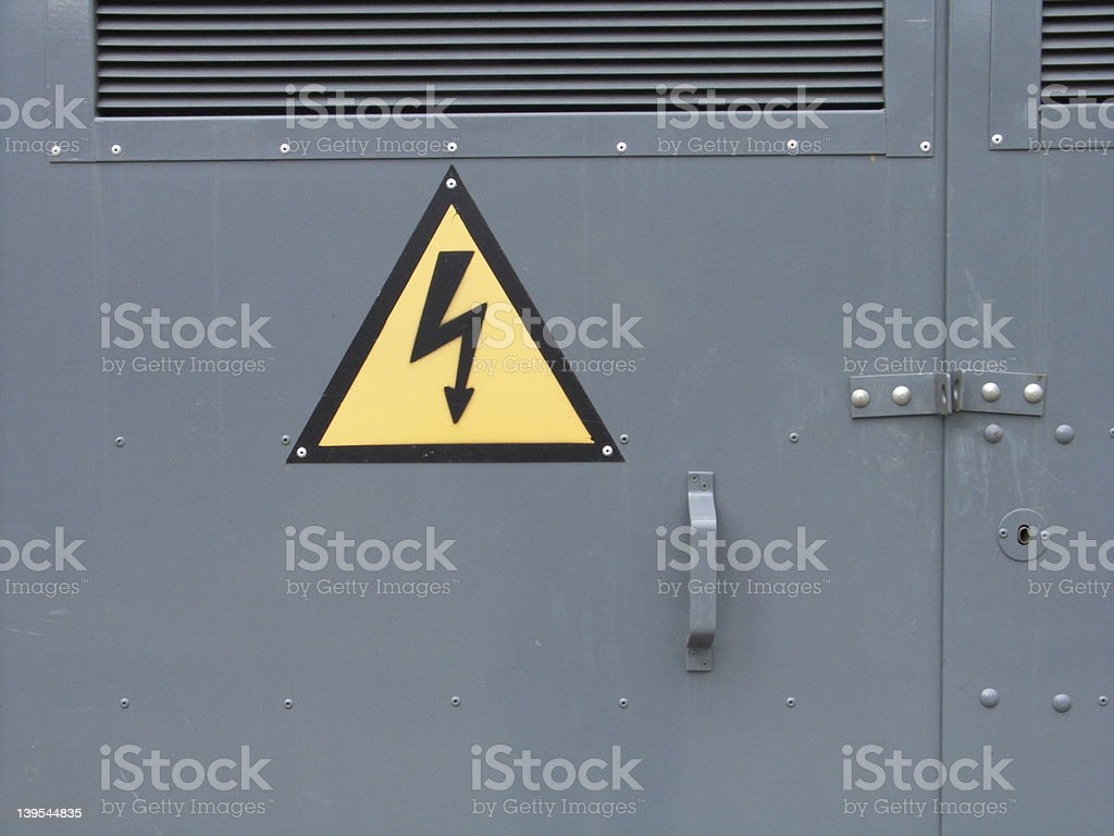 The door with High Voltage Warning stock photo