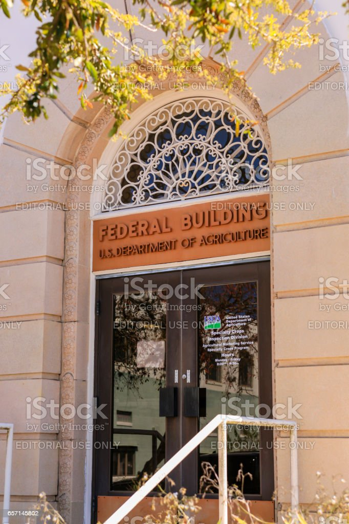 The doorway to the US Agricultural Department building in  Winter Haven, FL stock photo