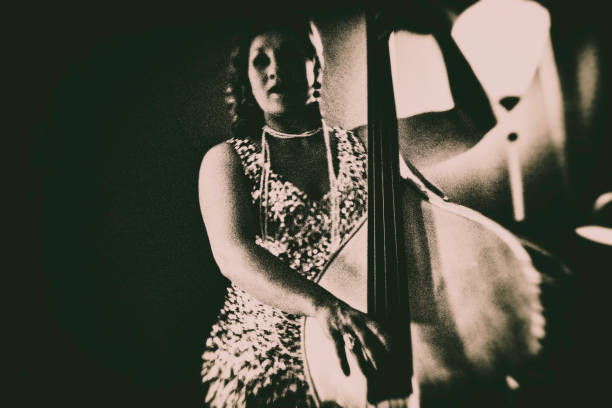 The double bass player in the Nightclub Double bass, Player, Nightclub, Jazz, chanson, vintage diva human role stock pictures, royalty-free photos & images