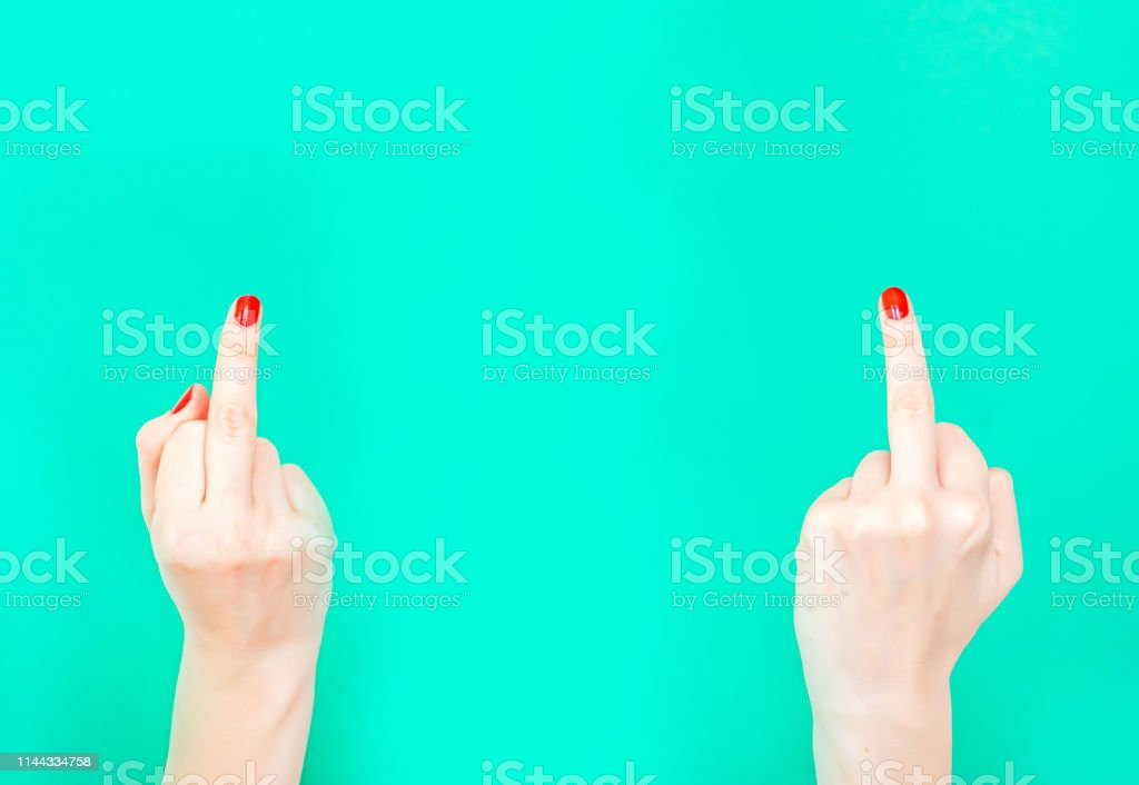 The Double Fuck You Hand Sign. Female hands showing middle fingers...