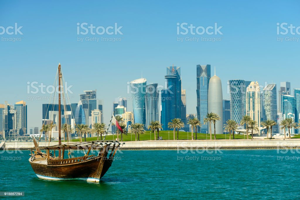 The Downtown Doha City Skyline and Traditional Boom boat, Qatar stock photo