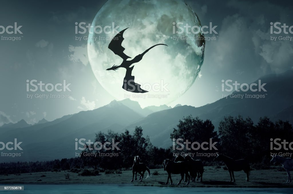 The dragon flies over the unicorns. stock photo