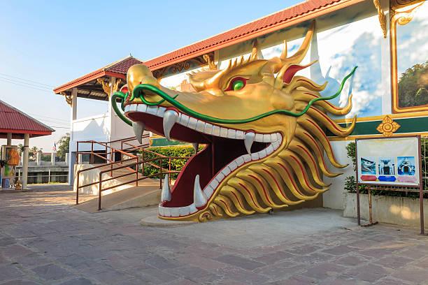 The dragon head door in temple Bangkok stock photo