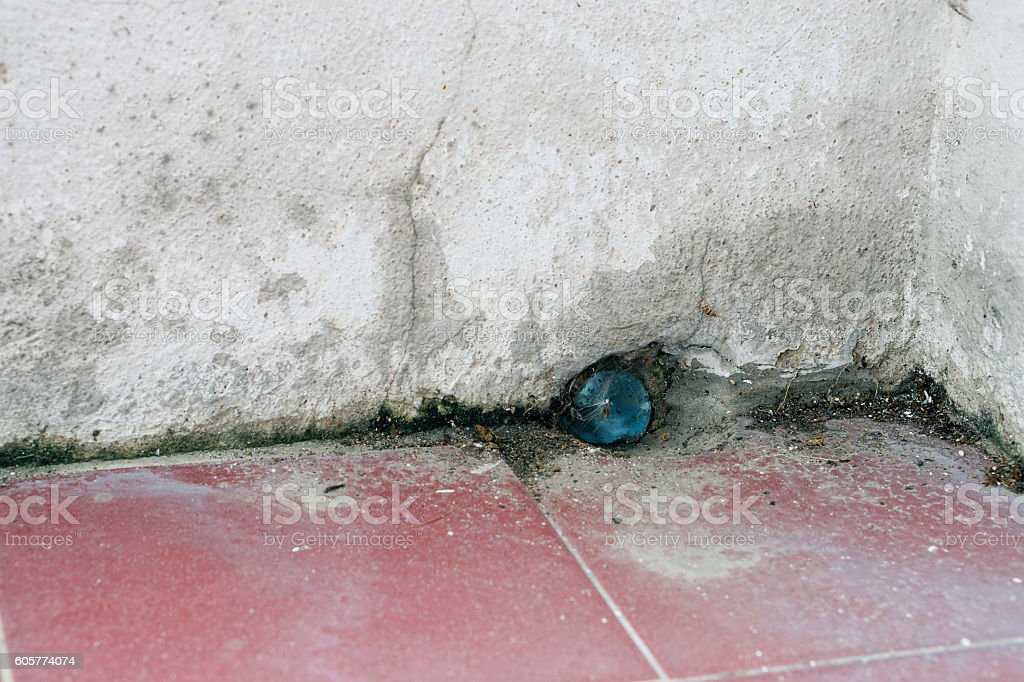 The  drain of the corner  of old building stock photo