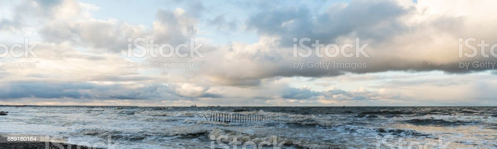 The dramatic cloudy sky over the Baltic sea at the sunset, with the...