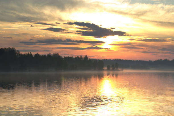 The dramatic sunrise over the river stock photo