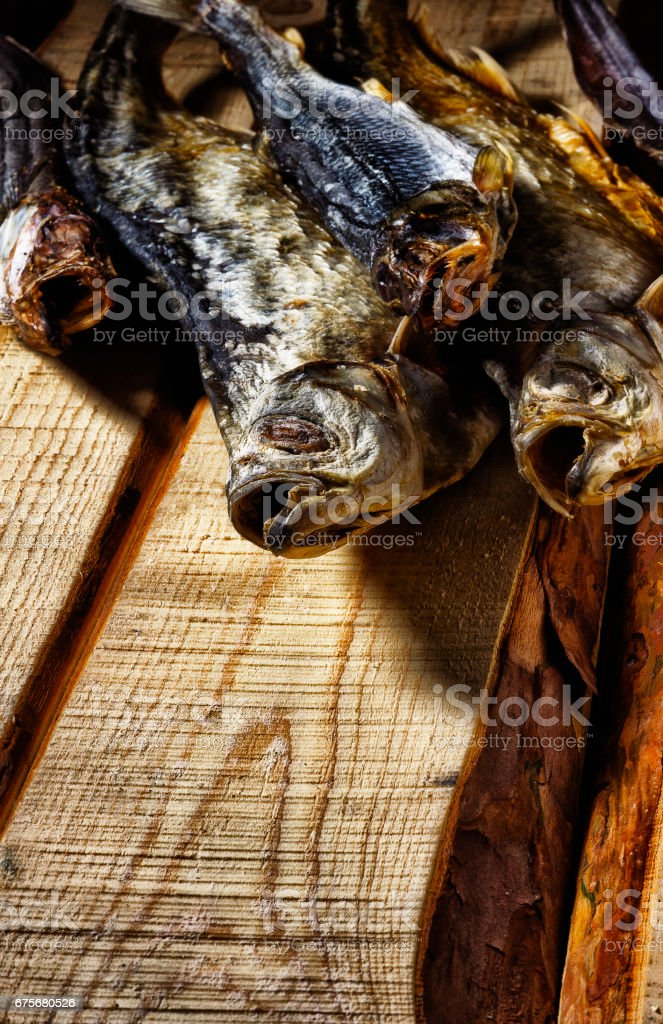 The dried fish lies on the boards royalty-free stock photo