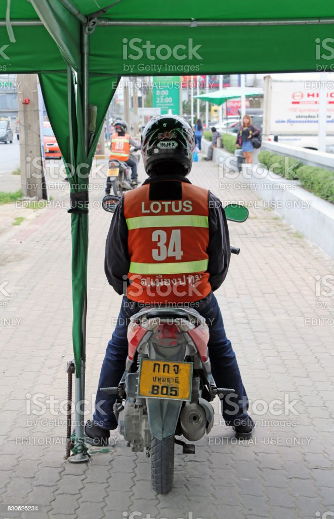 The driver who provide service transport by motorcycle. stock photo