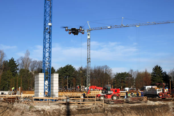 the drone flies over the construction site - drones stock photos and pictures