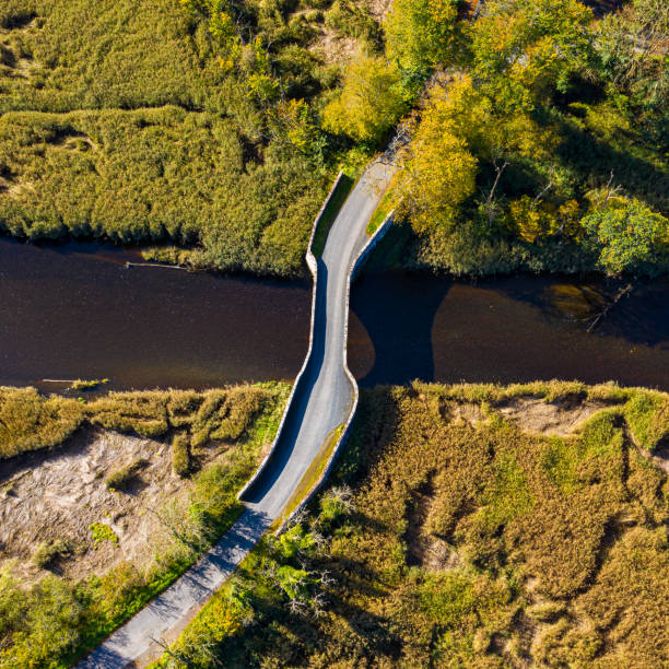 The drone view of an old stone bridge in Dumfries and Galloway south west Scotland The view from a drone of an old stone bridge crossing a small river that flows into an estuary in Dumfries and Galloway, south west Scotland. johnfscott stock pictures, royalty-free photos & images
