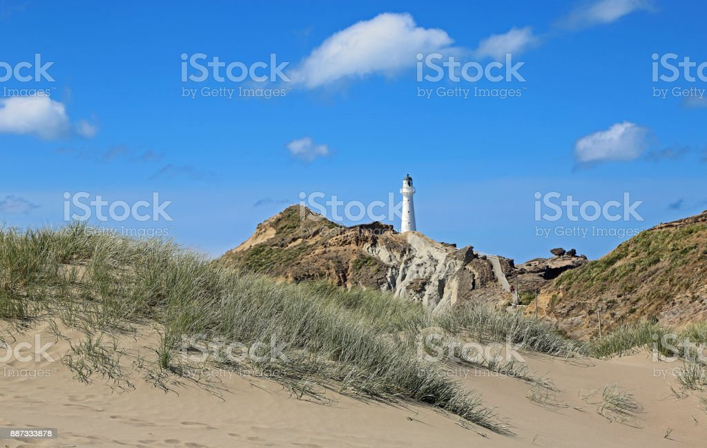 The dune and the lighthouse stock photo