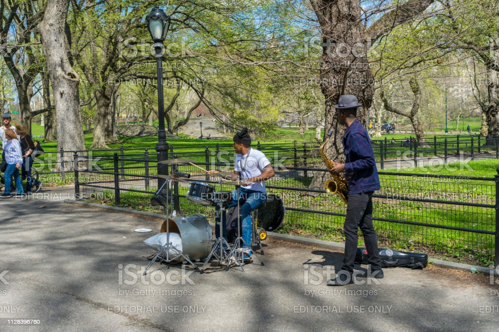 The duo jazz band performing at The Mall and Literary Walk in Central Park in New York,USA
