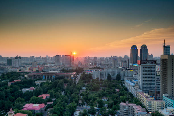 The Dusk of Harbin The Russian cottages at the foreground and skyscrapers behind has made the picture stunning. harbin stock pictures, royalty-free photos & images