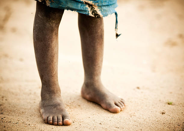 The Dusty Feet of an African Boy stock photo