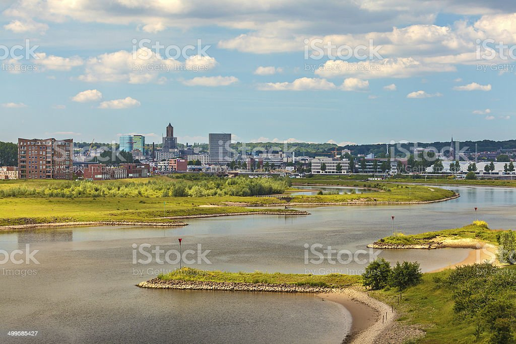 The Dutch city of Arnhem with the Nederrijn in front stock photo