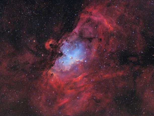 the eagle nebula with the famous pillars of creation - big bang foto e immagini stock