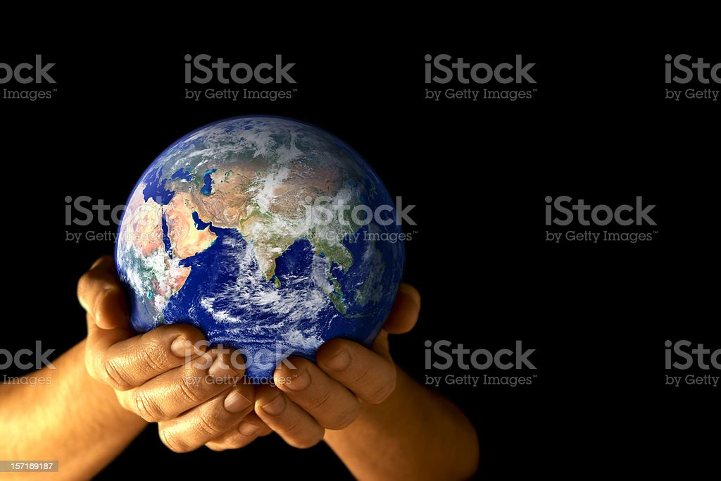 The Earth held in cupped hands with a view of Asia royalty-free stock photo
