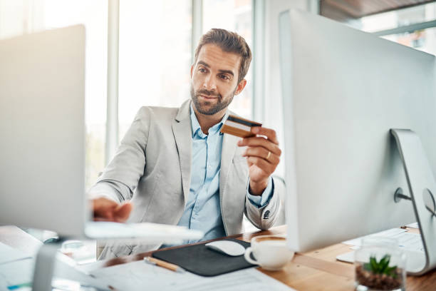 the ease of online banking - business credit card stock photos and pictures