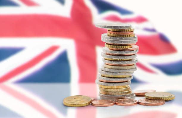 the economy of this country Coins stacked on each other in different positions with United kingdom flag british currency stock pictures, royalty-free photos & images