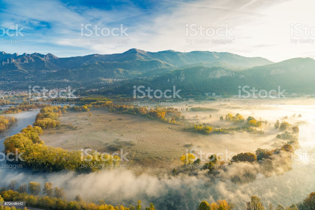 The Eden valley - View of the Adda river during a foggy morning, Airuno, Italy stock photo