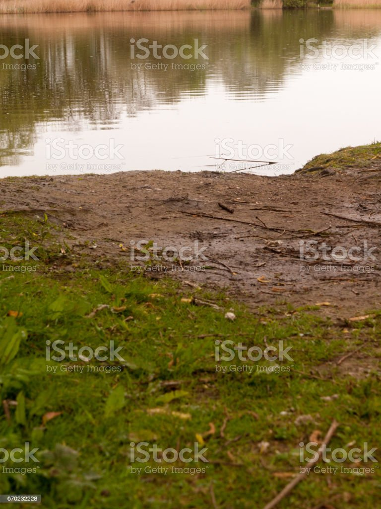 The Edge of the River Bank at a Low Angle on a Wet and Rainy Spring Day stock photo