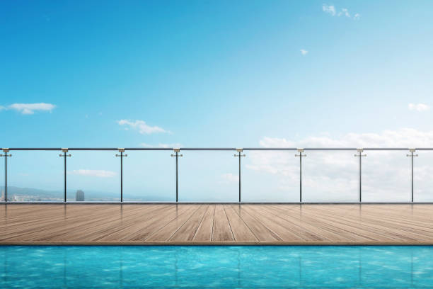 The edge swimming pool on the building balcony stock photo