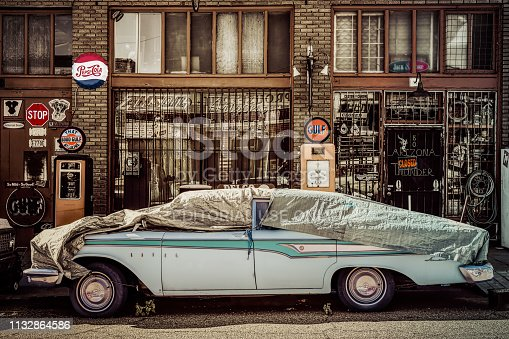 Lowell, Arizona / United States - November 25: A 1959 Ford Edsel sits parked and covered in tarps at Erie Street on November 25, 2018 in Lowell.