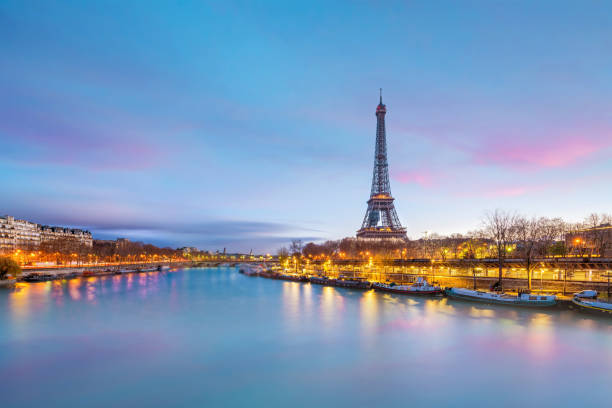the eiffel tower and river seine at twilight in paris - eiffel tower stock photos and pictures