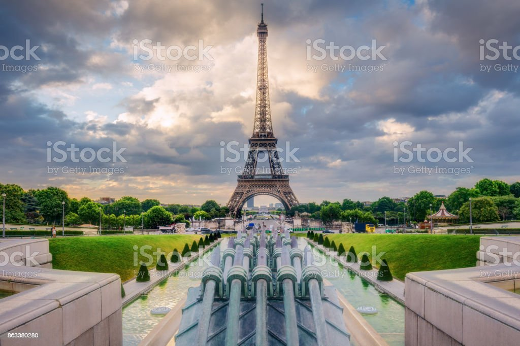 The Eiffel Tower in Paris, France, on a sunny day with Trocadero fountains. Spectacular cityscape with clouds. stock photo