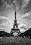 Summer sunshine falls on the Eiffel Tower in Paris. Black & white image.