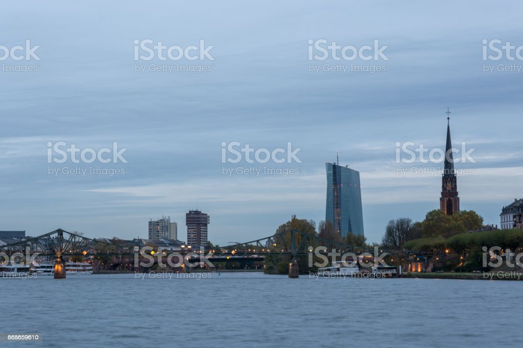 The 'Eisener Steg' bridge over the river Main in Frankfurt with the EZB bulding in the background stock photo
