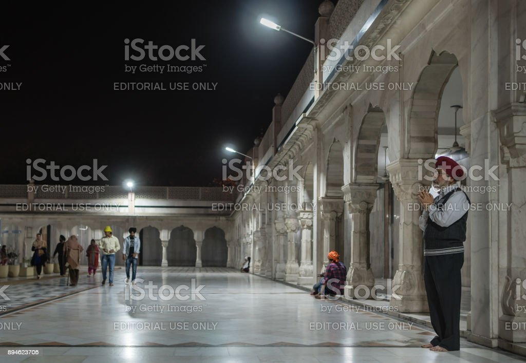 The elderly Sikh makes a prayer. stock photo
