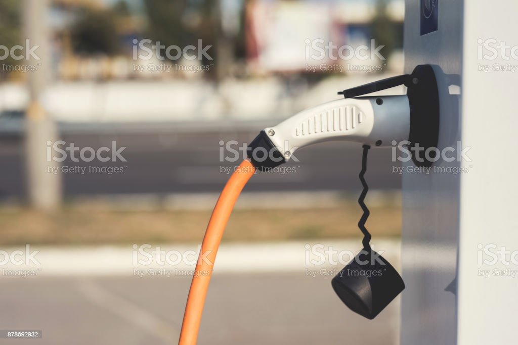 The electric machine stopped at the charging station to recharge. stock photo