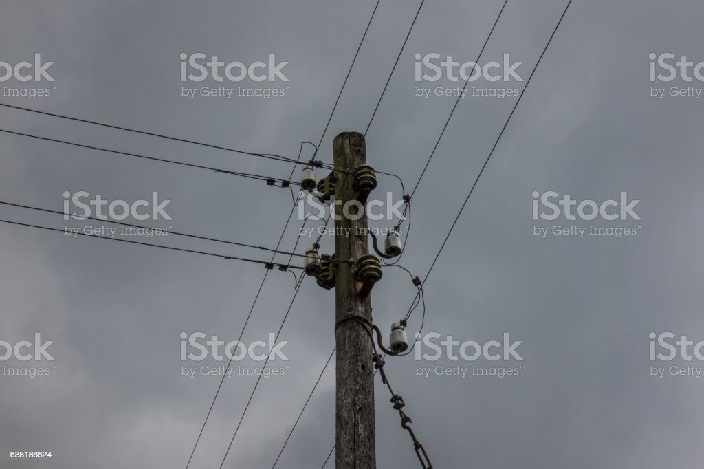 The electricity wooden pylon against a sky stock photo