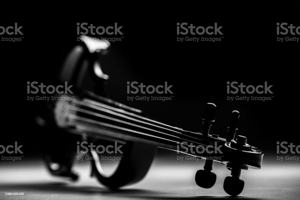 electronic violin on a black background