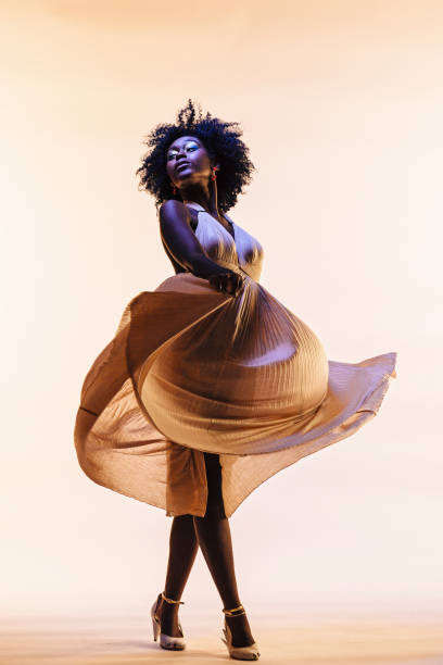 the elegant dancer, portrait of a beautiful woman swirling her dress - prom fashion stock photos and pictures