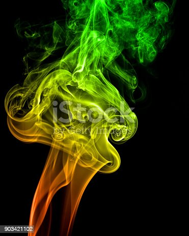 A streams of colored smoke on black background